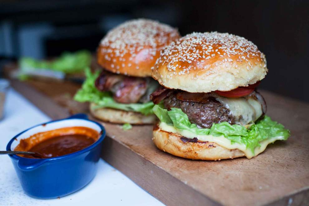 Beef burger served on a wooden tray