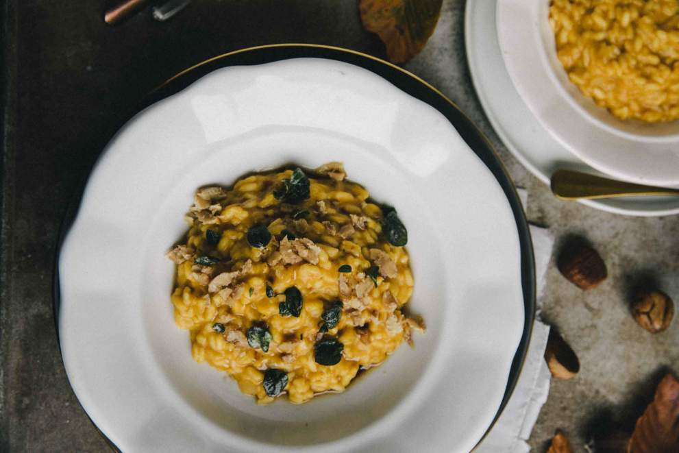 Chestnut and squash risotto served in a bowl with crispy sage