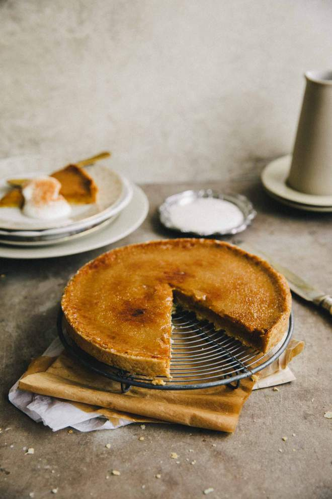 Bruleed Pumpkin Pie served with sour cream and cinnamon