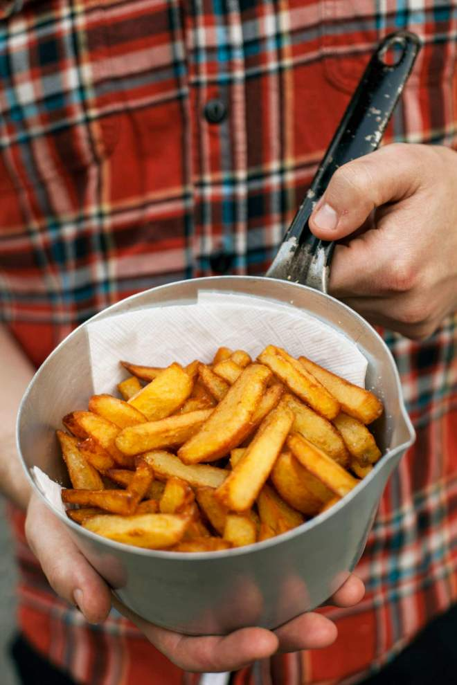 Fried potatoes in a pan, thick and crispy