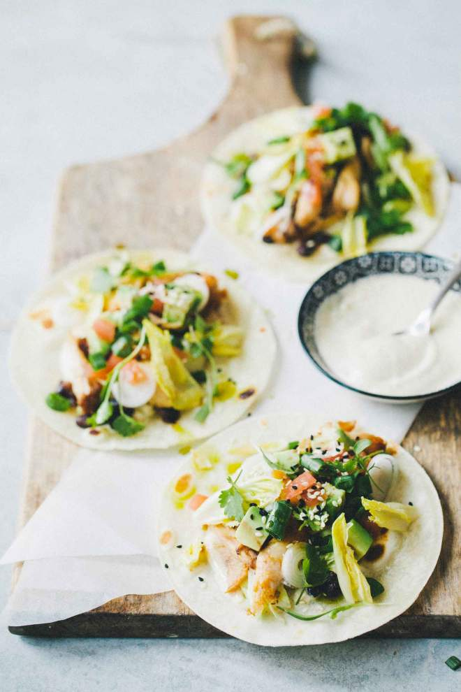Tacos with spicy chicken wings and fresh topping