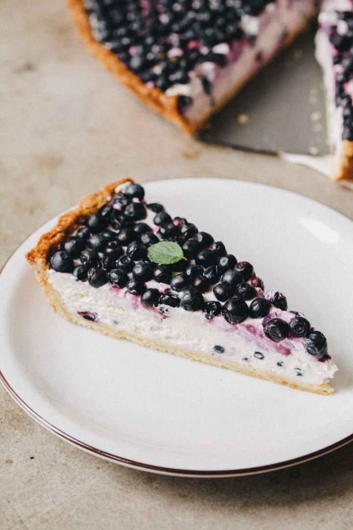 Slice of Homemade Blueberry Tart with Light Yogurt Cream