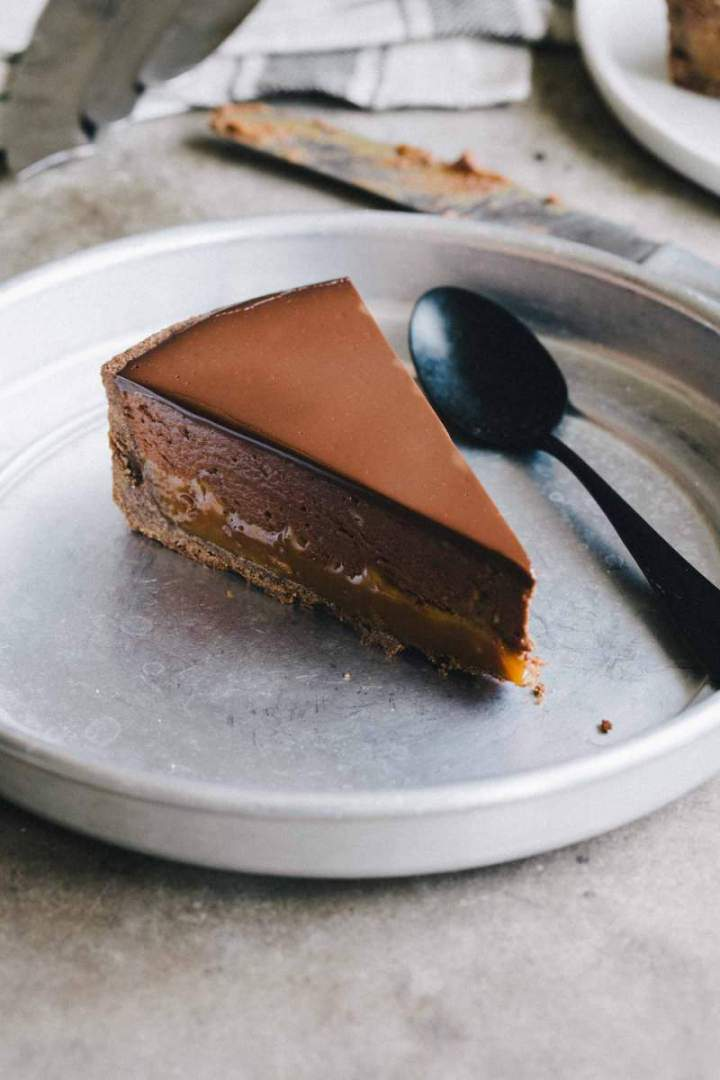 Slice of Buckwheat pie with chestnuts, caramel and chocolate