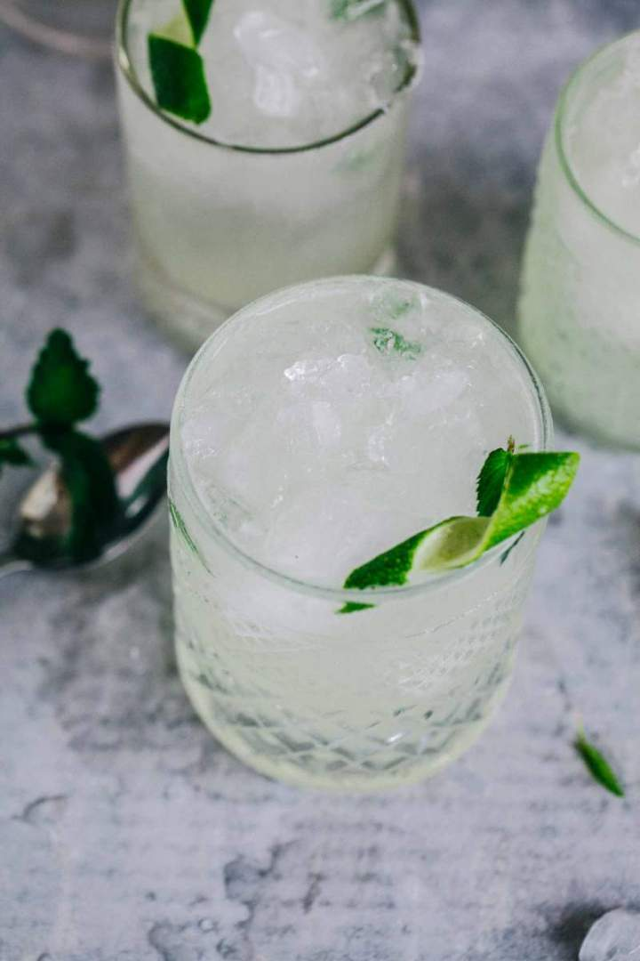 Elderflower mojito cocktail served with lime in a glass